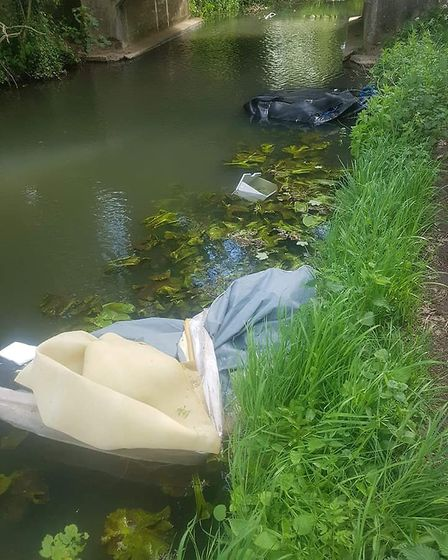 Waste dumped in the river at Knettishall Heath near Thetford. Photo: Eve Stoneburgh