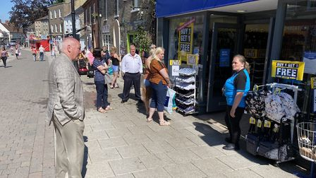 Breckland Councillor Roy Brame talking to the manager at Thetford's Shoe Zone. Photo: EmilyThomson