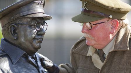 Mick Whitman in character with the Captain Mainwaring statue in Thetford. Picture: Jerry Daws