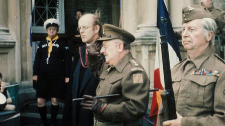 Arthur Lowe as Captain Mainwaring filimg outside the Guildhall in Thetford, now site of the Dads Arm