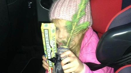 Chloe Preston, nine years ago, when she was about to plant her Christmas tree outside of her grandpa