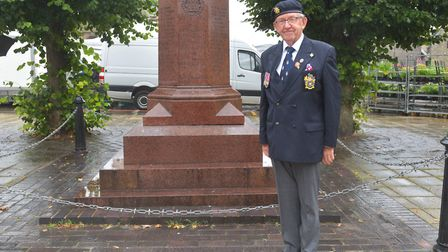 Colin Stevenson, son of WWII solider Norman Stevenson, is visiting Thetford's war memorial after his