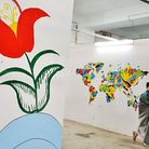 The flower on the left was the first mural to appear painted by an Afghan woman who refused to be ph