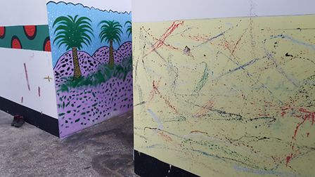 The resident who painted the wall on the right had never heard of Jackson Pollock. When we showed hi