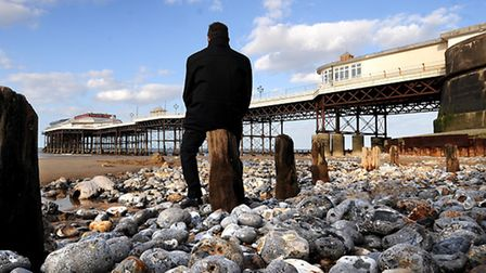 The beach level at Cromer has been lowered by winds and tides. Wooden stumps have been exposed.PHOTO