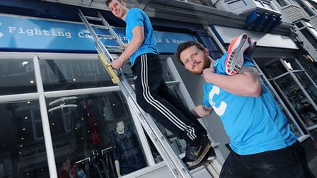 Window cleaner for Cromer's Big C charity shop, Ben Lucking, top, and his friend George Edge are run