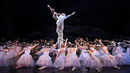 A high lift amid a circle of swans in a scene from English Youth Ballet's production of Swan Lake. P