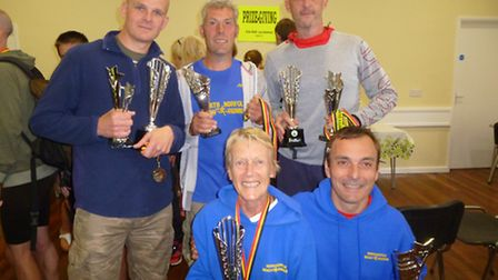 All smiles for North Norfolk Beach Runners prize-winners (from left to right) Jamie Seamark, Hugh Br