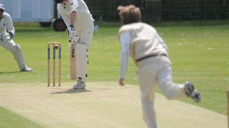 Cromer A bowler Alan Stickells delivering to Peter Hills during the game against Bradenham A. Pictur