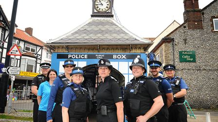 Sheringham clock tower turned into a police call box. Left to right, Sgt Andy Smith, NNDC environmen