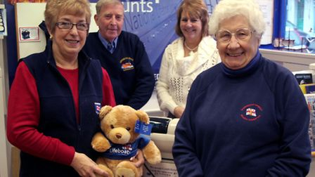Library picture of (left to right) Sheringham RNLI charity shop manager Anne Little with Des Keen, G