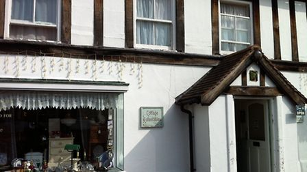 The outside of Cottage Collectables antiques store in Holt.