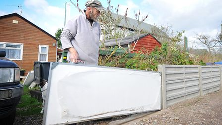 George King prepares his house on Helena Road, Walcott for the predicted storm.Picture: ANTONY KELLY