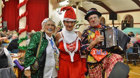 Razz the Clown and Auntie Pearl are joined by Hilary Cox at the Cromer Carnival Christmas concert. P