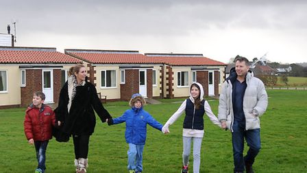 Tim Hay, the new owner of Mundesley Holiday Park pictured with his wife Mo and their children Millie