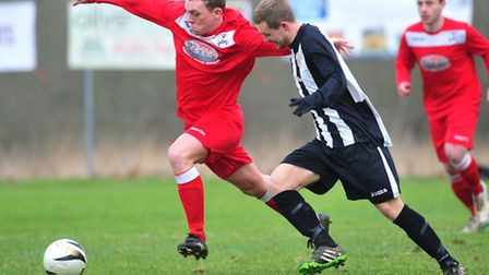 Action from the clash between hosts Acle (black and white) and Reepham which ended in a 3-2 win for