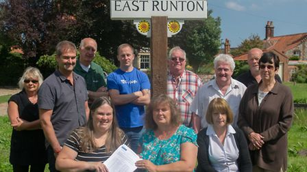 Business owners and residents handing over the petition to keep the East Runton Funfair in its usual