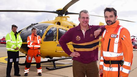 Norfolk farmer Tim Papworth meets the air ambulance doctor, Haris Begovic, who helped save his life