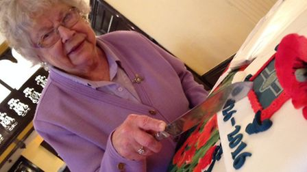 Oldest member Olive Gibson cuts the cake to mark the 90th anniversary of the Cromer's Royal British