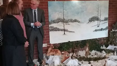 Peter Longstaff, who was born without arms, has donated a painting of an autumn and winter scene to