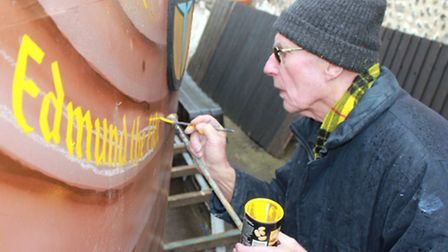 Scira festival founder Colin Seal painting the Viking name of reenactor Chris Wilkins, who died last