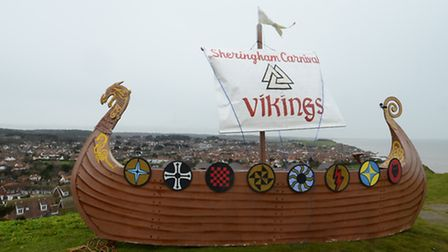 To mark the run up to the Viking Festival in Sheringham, members of the Carnival organisers carry a