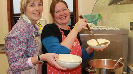 Community Matters Cafe volunteers Olivia Reid and Kathy Findlay preparing chunky minestrone soup and