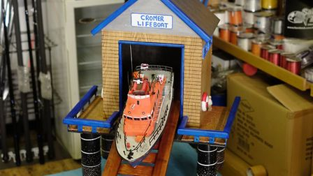 Manger Christian Bulch, of the Sabre Fishing tackle shop in Cromer with his model Lifeboat house for