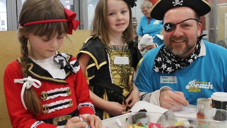 "Beachlife crew member Simon ""Cap'n Greybeard"" Fenn helping pint-sized pirates Morag and Darcey with"