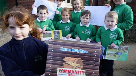 Pupils at Colby Primary School with their Eastern Daily Press Community Chest with which they hope t