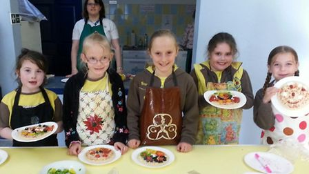 Suffield Park Brownies with their pizza creations.