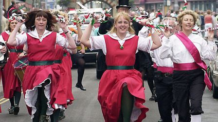 Sheringham Lobster Potty Festival, the Hoxon Hundred from Diss make their way down High Street. SR4o