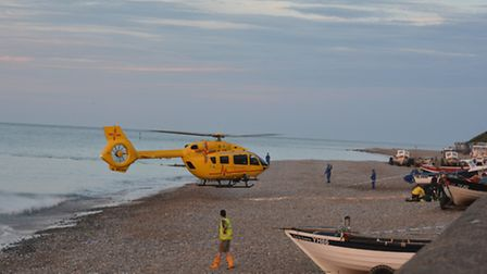 The air ambulance is pictured landing on the beach in Cromer. Photo: Dave 'Hubba' Roberts