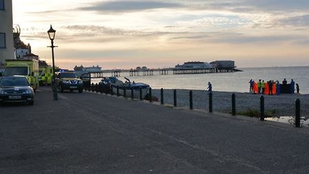 Emergency services rushed to the scene near Cromer pier after the alarm was raised. Photo: Dave 'Hub