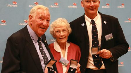 Peter Poll, Rita Poll and Philip Smith with their awards.