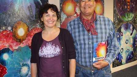 Community librarian Maria Pavledis with Jamaican-born artist Danny Keen, whose paintings are on show