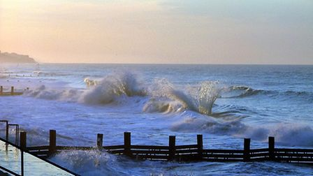 Waves crashing at Walcott beach. Picture by George Woodhouse