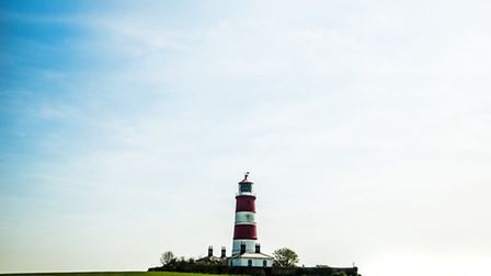Happisburgh lighthouse on a beautiful and windy day. Picture by Paul Carver
