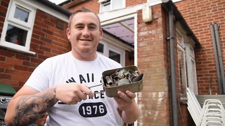 Steven Attew with the box of bits that had belonged to his grandad, which contained the small mortar