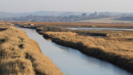 Salthouse village viewed across the marsh from the East Bank at Cley. Photo: Simon Bamber