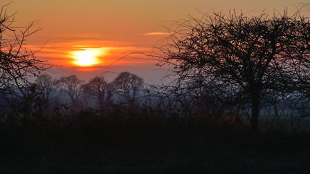 A view west from North Walsham of the sun setting and mist rising. Photo: Brian Hicks