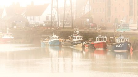 A foggy afternoon at Wells-next-the-Sea. Fishing boats returned after completing their catch. Photo: