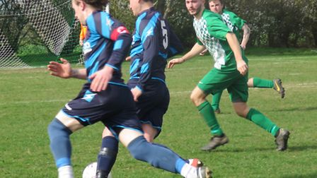 Trimingham Pligrims pair Jack Crane and Lewis 'Chewy' Smith take on the Phoenix defence. Picture: To