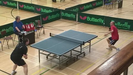 Chris Fuller in mid service-action against Robin Thaxter in the semi-finals of the North Norfolk Cha