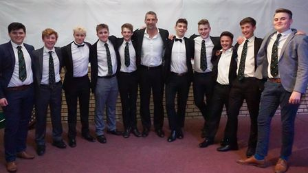 Members of North Walsham's colts team pose for a picture with former British Lions and England star