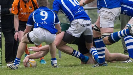 Action from the Norfolk Senior Cup final between North Walsham and Diss (blue). Picture: Hywel Jones