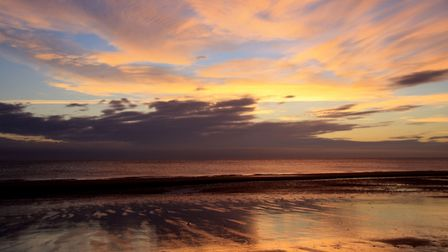 Early morning sunrise over West Runton beach. Picture: Jo Johns