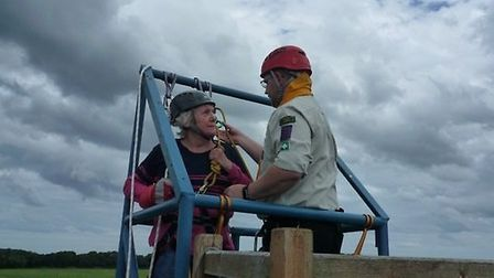 Christine Wood, 71, has completed an 53ft abseil to raise money for charity. Picture: BRIAN POOLE.