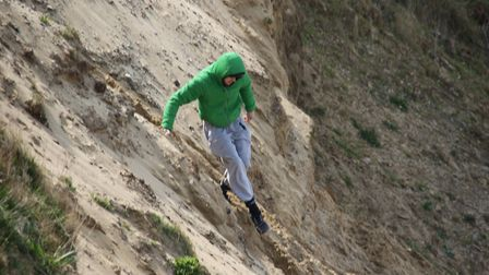 Visitors to the coast are continuing to ignore warnings not to climb on the crumbling cliffs. Pictur