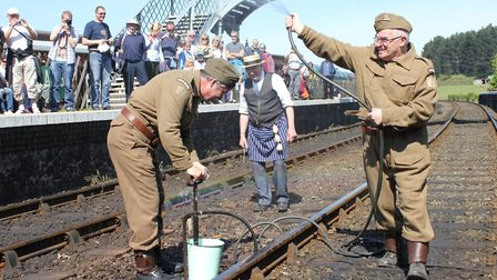Sergeant Wilson giving Pte Pike (and the crowd) a soaking at Weybourne station at a previous year's